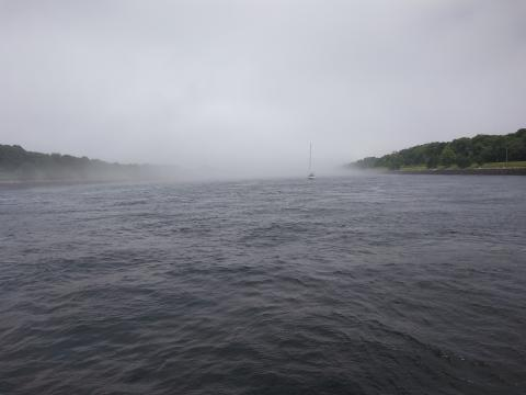 Sailboat entering fog in Cape Cod Canal