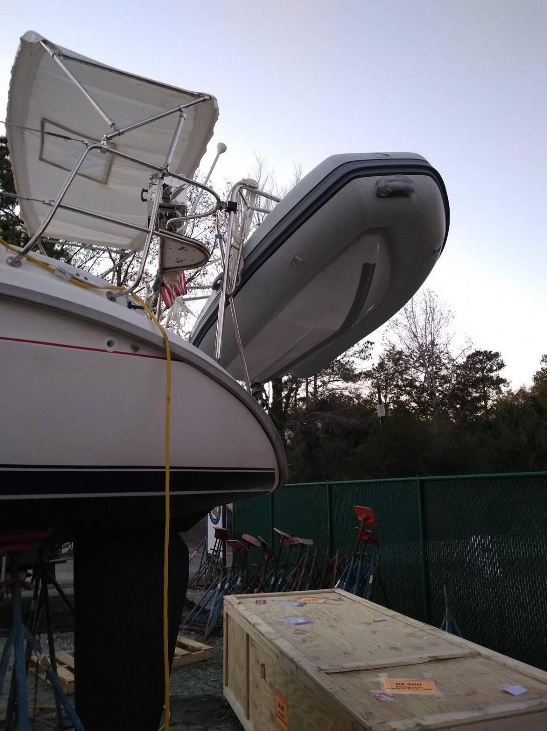 Dinghy hanging from new dinghy davits